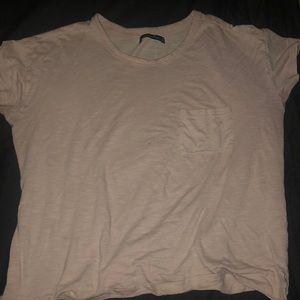 a pinkish cream color short sleeves shirt